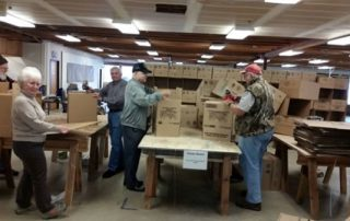 Building boxes for Christmas Basket food drive.
